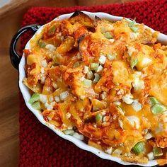 Ingredients       8 cups Ranch flavored tortilla chips (I used Cool Ranch Doritos)   4 cups cooked chicken shredded   1 1/2 cups Frank's Buffalo Wing sauce   water   3 cups shredded cheddar cheese   4 ounces blue cheese crumbles