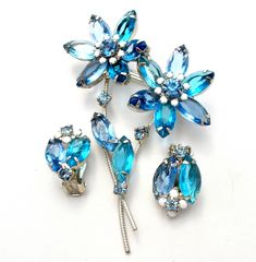 Rare D & E for Juliana Floral Jewelry - This is a vintage silver tone flower pin and earring set with 3 colors of blue rhinestones and white milk glass. The brooch is a double flower and measures 3.25