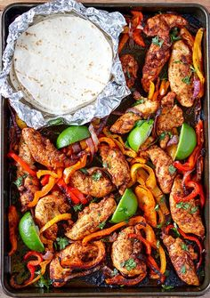 These Sheet Pan Chicken Fajitas are a snap to make and they are so delicious! Colorful bell peppers, red onions and chicken tenders simply tossed together with olive oil and spices. Squeeze fresh lime juice over them after cooking, sprinkle with fresh cil Mexican Food Recipes, Dinner Recipes, Dinner Ideas, Party Recipes, Irish Food Recipes, Seafood Recipes, Cooking Recipes, Healthy Recipes, Crockpot Recipes