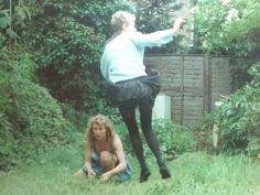Jumping Alison and her friend Sharon in Sarah's garden / North London / Early