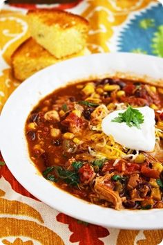 "Crock Pot Chicken Chili Recipe.  Chicken taco chili...only about 200 calories a serving and makes 8 servings! 1 can black beans, 1 can kidney beans, 1 can corn kernels, 16 oz tomato sauce, 28 oz diced tomatoes, packet taco seasoning, 1 tbsp chili powder, 3 boneless chicken breasts. 6 hours high or 10 hours low in the crock pot. i'm substituting morningstar ""chik-un"""