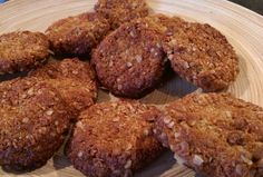 Oat & Coconut Biscuits 85g Oats, 85g Dess. coconut, 100g plain flour, 100g caster sugar, 100g butter, 1 tblsp golden syrup, 1 teasp bicarb mixed with 2 tblsp boiling water. Melt butter & syrup & bicarb mix, mix in dry ingredients. Chill 1/2 hour, then make into balls. Bake on greased tray for 10 mins at 175 deg. C. Flatten balls then bake for 2 more minutes if necessary.