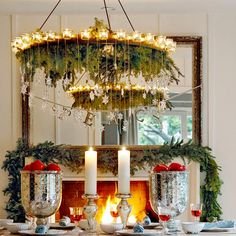 Garland isn't just for banisters and mantel - wrap it around your chandelier. More DIY garlands: http://www.bhg.com/christmas/garlands/holiday-garland-ideas/#
