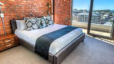 Cape Town Penthouse is a luxury self-catering holiday apartment in De Waterkant with 3 bedrooms. New York Loft, Small Business Solutions, Exposed Brick Walls, Penthouse Apartment, Travel Companies, Loft Style, Luxury Villa, Cape Town, Outdoor Furniture