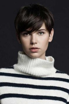 Easy Short Pixie Hair Cut : The choppy razor hairstyle shows of the soft texture of the platinum hair.A combination of medium to long layers cut throughout the back and sides creates the layered hairstyle much movement.The front layers are kept longer and thinned just kissing the eyes.It looks boyish and is simple to maintain. pixie haircuts, short haircuts, layered hairstyles, short hair styles, haircut styles, short hairstyles, short pixi, girl hairstyles, easi short
