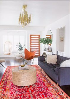 Modern bohemian inspired living room with a large rug, gray sofa, and a chandelier bohemian living room colour babyproofing casa samuel Apartment Living, Home Living Room, Interior, Bohemian Living Room Decor, Home Decor, Living Room Inspiration, Interior Design, Living Decor, Home And Living