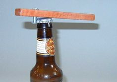 beer bottle opener by newberry on Etsy, $12.00. doesn't wrinkle the cap, so if you're a collector, this is the way to go.