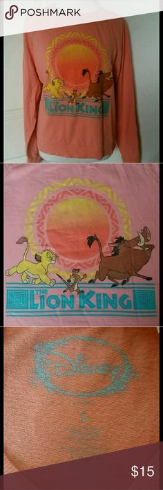 Disney Lion King Sweatshirt This Disney brand Lion Kind sweatshirt is any Disney lovers dream with its comfort and very good condition. It is a size large and it's 100% cotton. Disney Sweaters Crew & Scoop Necks