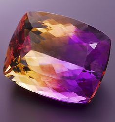 Here is one gorgeous Ametrine cushion weighing 27.19 cts, from Bolivia. Ametrine is an unusual variety of quartz which exhibits the colors of amethyst and citrine side by side.
