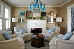 Lauren Leiss, love the sitting room, four chairs, beautiful blue glass chandelier
