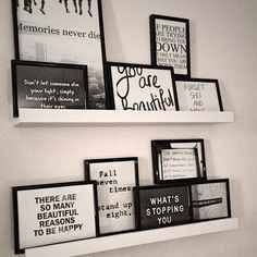picture frame shelves with lots of framed quotes/sayings