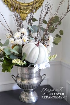 Create a DIY fall flower arrangement in 10 easy steps. Featuring dollar store fake flowers and a chalk paint pumpkin, you'll love this fall display.