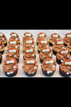 "Tow Mater cupcakes with chocolate buttercream, royal icing accents and fondant ""teeth""."