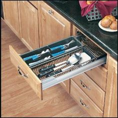 """Rev-A-Shelf 5391-21CR Pull-Out Cutlery/Utensil Organizer - Wire-Chrome/Crominox by REV-A-Shelf. $205.10. Width: 20-1/8"""". Depth: 22"""". Crominox Finish. Height: 3 1/2"""". Say good-bye to fumbling through your drawers for the right cooking utensil thanks to Rev-A-Shelf's new Cutlery/Utensil Organizer. They are coated in Crominox, a transparent epoxy designed to provide better protection for stored items. The 24"""" base drawer unit has a 4 section tray for silverware a..."""