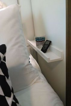 Small but serviceable bedside table idea for couples who have their bed pushed up against a wall.