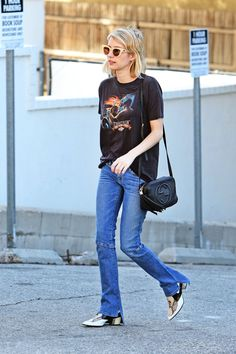 Emma Roberts was photographed shopping in West Hollywood (at Isabel Marant) wearing a vintage tee tucked just so into her faded jeans. Her Rodarte snakeskin boots stole the show, as they are wont to do.