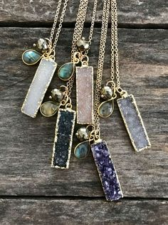 Super sparkly, druzy quartz bar is garnished with flashy labradorite and pyrite beads along a 14K gold fill cable chain. These stones are 100% natural, meaning they have not been dyed, treated or enhanced in any way. Rectangular druzy pendant measures approximately 1 1/4 tall x 3/8
