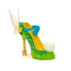 This dazzling Tinker Bell Miniature Decorative Shoe will make a perfect gift. Our ornamental shoe collection captures the magical spirit of Disney in each of its character-based designs.