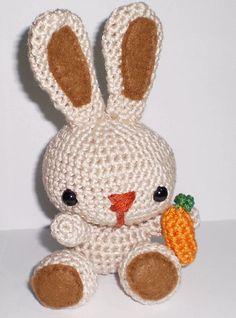 Amigurumi rabbit with carrot, kawaii style, all handmade with pure cotton. $20.00, via Etsy.
