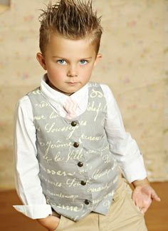 This boys gray vest from Mustard Pie is an adorable way to dress up your little gentleman!  Front button closure with brass look buttons, vintage cream print and gray cotton fabric will have this lightweight boys vest being the perfect choice to add an extra bit of oomph to his special occasion outfit.  This vest for toddler and little boys is a popular choice for weddings, pictures, Easter and parties!