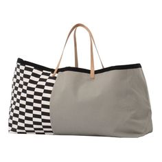 This Herman Big Bag in grey designed by the Herman Studio in conjunction with Ferm LIVING is exactly that. A great big bag for that weekend away or for storing lots of things in the home each season.  It is a large and generous heavy cotton canvas bag with strong leather handles. A contemporary design with black and white chequered pattern on one half and a plain warm grey section on the other. The perfect getway big bag or for those of you off to the gym or on your travels.