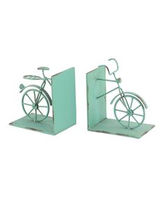 Fun bike bookends. Love the minty green color.