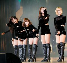 Asian girl group onstage in black OTK boots