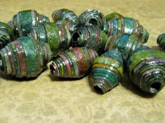 Paper beads I rolled using black cardstock and water color paints.