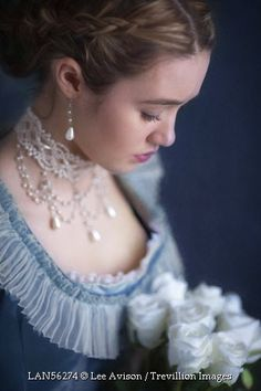Trevillion Images - historical-woman-holding-white-roses