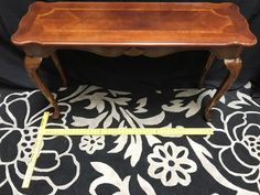 QUEEN ANNE STYLE CONSOLE TABLE WITH INLAY TRIM, CARVED SHELL EMBELLISHMENT AND CABRIOLE LEGS. 30H X 48W X 16D