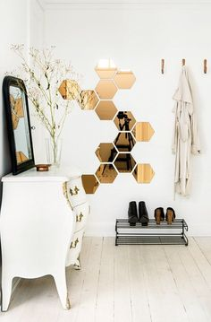 HÖNEFOSS Hexagonal Honeycomb Mirror from Ikea. 10 mirrors for $14.99. (Link to photo here: http://www.planete-deco.fr/2014/09/05/du-cuivre-pout-reveiller-deco/)