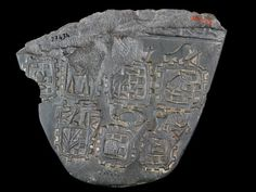 Fragment of the 'Libyan Tribute Palette', from Abydos. Naqada III, ca. 3200-3000 BC. Schist, 19 x 22 cms. Now in the Egyptian Museum, Cairo. JE 27434.