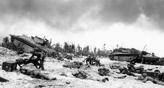 Supported by tanks, Marines of the 1st Marine Division inch their way up on the beach of Peleliu, during the invasion of the island in the Palau group, on September 14, 1944 AP Photo/Joe Rosenthal