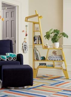We don't think it's a stretch to say our giraffe-shaped bookcase will make a welcome addition to any nursery or play space. Its oh-so-tall frame and various compartments will provide room for all of your little one's favorite books, toys and trinkets. Designed exclusively for us by Royce Nelson.