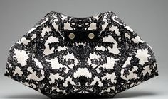 In our eyes, Sarah Burton for Alexander McQueen can do no wrong, especially when it comes to clutches. The Spring/Summer 2012 collection featured an array of fabulous designs, but we were particularly smitten the De-Manta Clutch ($525), which blends the fashion house's signature edgy couture sensibility with the season's lace infatuation.