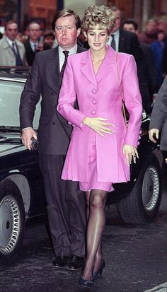 November 14, 1992: HRH Diana, Princess of Wales with Ken Wharfe visiting the Cite de la Musique at La Villette in Paris during her 3 day visit to France.