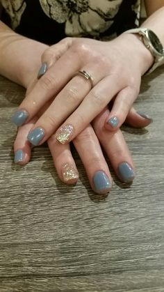 Periwinkle gel nails with a sparkle accent - nailsbyailesh