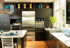 9 Examples Of Kitchens With Built-In Coffee Machines // A open shelf above this built-in coffee maker provides a convenient spot for a few extra mugs.
