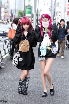 Colomo and Melochicon - both 19 - on the street in Harajuku wearing oversized sweatshirts, loafers, and lots of cute accessories. Their looks include items from Nesin Harajuku, Zzz…Tokyo, Spinns, Disney, Vivienne Westwood, Kirby, and Care Bears.