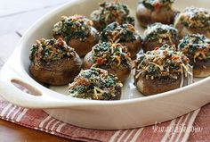 Mushroom caps are generously stuffed with a combination of sautéed baby spinach, chopped mushrooms, bacon, bread crumbs and Parmesan cheese. A lighter alternative to traditional stuffed mushrooms yet loaded with tons of flavor. The stuffing is so good, I could eat it by the spoonful!  I like the flavor of real bacon, so I buy center cut which is a bit leaner than regular bacon and I drain it well after cooking. Can you make them with turkey bacon? Sure, if you don't eat pork that would wo...
