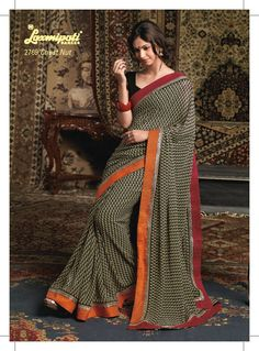 This Off white & black color Georgette material saree with elegant  orange border patta