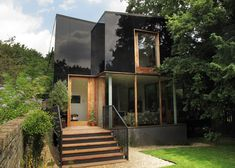 http://www.dezeen.com/2014/10/31/ian-mcchesney-sydenham-house-south-london-black-glass-facade/
