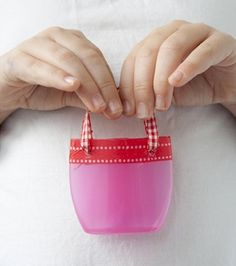 recycle a plastic bottle into a cute little basket or miniature tote; found at Pysselbolaget
