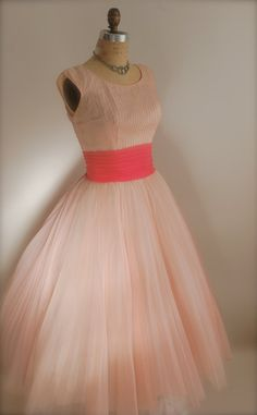 Cute vintage dress. How do I look in pink?!
