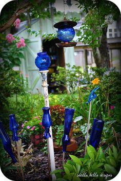 Beautiful blue bottles make pretty garden art.