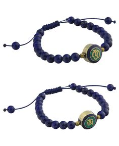 Om bracelet with lapis beads and double sided brass charm. Handmade in USA by Tibetan artists, available at BuddhaGroove.com.