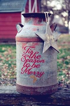 Old Milk Can...decorated for the Holidays. by regina