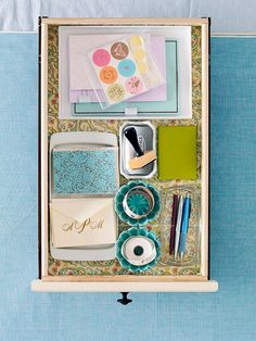Use small serving pieces (with a bit of adhesive to keep them in place) to organize your stationary drawer.
