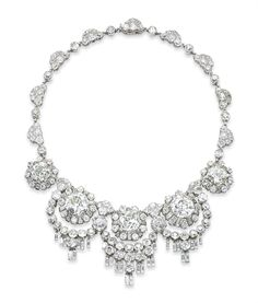 A UNIQUE DIAMOND NECKLACE, BY RENÉ BOIVIN The front section set with five cushion-shaped diamonds, weighing 6.52, 8.07, 9.82, 9.16 and 5.57 carats, each in a baguette and circular-cut diamond frame, with diamond quatrefoil spacers, suspending a detachable circular and baguette-cut diamond fringe, to the diamond neckchain, circa 1960, 37.1 cm, with French assay marks for platinum and gold, in original brown suede fitted René Boivin case