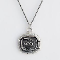"Well Being Talisman Necklace fro Pyrrha. My god, I am in love with their talismans...  ""While in the shape of a horizontal number eight, the symbol for infinity, the snake on this handcrafted talisman necklace represents enduring health."""